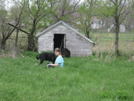 Katherine and Meeko in front of an old chicken house that will be a temporary dog house.