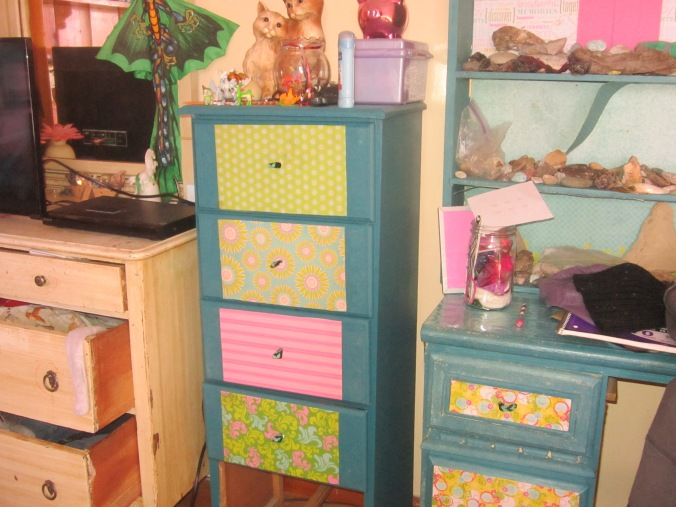 same dresser  painted and decorated with ribbon and scrapbook paper
