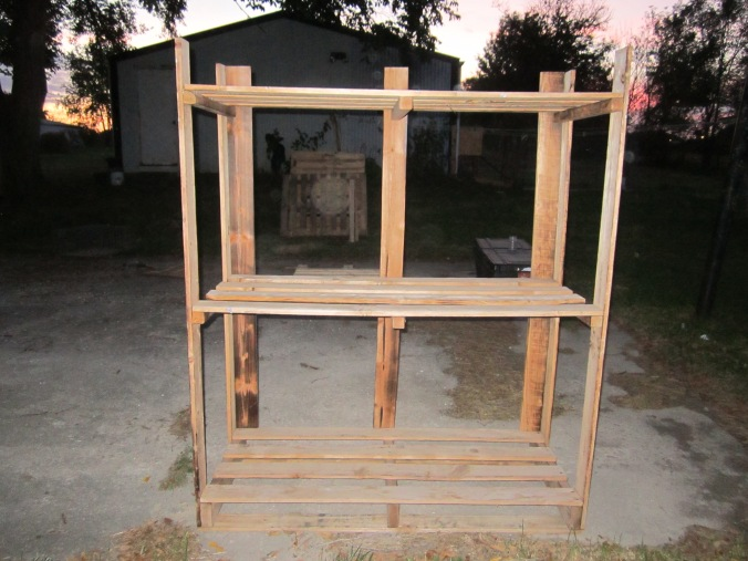 wood frame with pallets in the background.